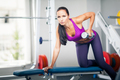 Beautiful lady working out with dumbbell - PhotoDune Item for Sale