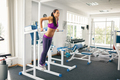 Sporty woman doing pull-ups in gym - PhotoDune Item for Sale