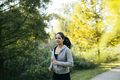 Fit beautiful woman jogging in park - PhotoDune Item for Sale