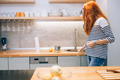Woman keeping kitchen tidy and clean - PhotoDune Item for Sale