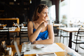 Stunning woman enjoying her coffee in restaurant - PhotoDune Item for Sale