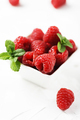 Sweet fresh raspberry on the white stone background - PhotoDune Item for Sale
