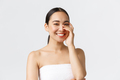 Beauty, cosmetology and spa salon concept. Close-up of gorgeous asian woman in bath towel laughing - PhotoDune Item for Sale