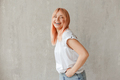 Young joyful woman in white t-shirt with dyed hair laughing - PhotoDune Item for Sale