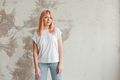 Young woman wearing blank vest. Concrete wall background. - PhotoDune Item for Sale