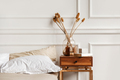 Cozy details in white contemporary bedroom interior with gypsum stucco on white walls - PhotoDune Item for Sale