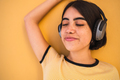 Young woman listening music with headphones. - PhotoDune Item for Sale