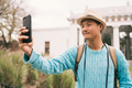 Asian tourist taking a selfie with mobile phone. - PhotoDune Item for Sale