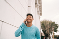 Asian man talking on the phone outdoors. - PhotoDune Item for Sale