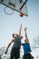 Two young friends playing basketball. - PhotoDune Item for Sale