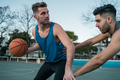 Young basketball players playing one-on-one. - PhotoDune Item for Sale
