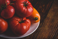 Fresh red and yellow tomatoes on plate - PhotoDune Item for Sale