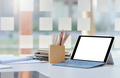 Close-up shot of Tablet mockup blank screen on desk in comfortable office. - PhotoDune Item for Sale