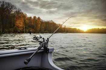 Fishing rod on the boat. Autumn season