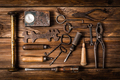 Collection of rusty tools and keys in vintage style on wooden background - PhotoDune Item for Sale