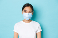 Covid-19, social distancing and coronavirus pandemic concept. Close-up of young asian woman looking - PhotoDune Item for Sale