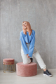 Portrait of sexy fit woman wearing ripped pants sportswear standing at concrete wall - PhotoDune Item for Sale