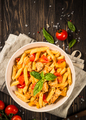 Pasta with chicken and vegetables at wooden table - PhotoDune Item for Sale