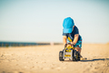 Toddler boy playing on a sunny beach - PhotoDune Item for Sale