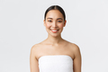 Charming smiling young asian woman in towel looking at camera happy as finish her daily skincare - PhotoDune Item for Sale