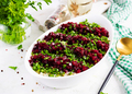 Kosher food, jewish salad. Herring,  pickled cucumber, beet, potato and apples salad on white  bowl. - PhotoDune Item for Sale