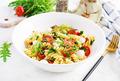 Pasta salad. Fusilli Pasta - Caprese salad with tomato, mozzarella and basil. - PhotoDune Item for Sale