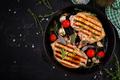 Grilled pork steaks in frying pan on dark background. Top view, overhead, copy space - PhotoDune Item for Sale