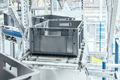 Modern roller conveyor system with plastic boxes. - PhotoDune Item for Sale