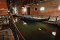 Venice Gondola boat in small channel in lagoon city Venice at night. Long exposure Venezia Italy - PhotoDune Item for Sale
