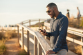 Latin man taking selfies with a smartphone over an amazing sunset landscape view - PhotoDune Item for Sale