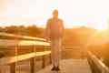 Happy latin man walking and enjoying the sunset with a natural landscape view - PhotoDune Item for Sale