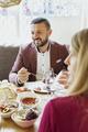 Happy couple having meze at table in Lebanese restaurant - PhotoDune Item for Sale