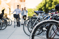 Friends walking at bicycle parking lot - PhotoDune Item for Sale
