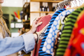 Cropped image of woman selecting clothes in store - PhotoDune Item for Sale