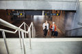 High angle view of businesswomen moving up steps at railroad station - PhotoDune Item for Sale