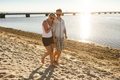 Young couple walking at beach - PhotoDune Item for Sale
