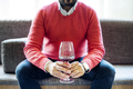 Midsection of man holding red wineglass while sitting at Lebanese restaurant - PhotoDune Item for Sale