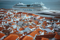 Rooftopspanorama of the oldest district Alfama in Lisbon. Cruise boat on the Tagus River. Lisbon - PhotoDune Item for Sale