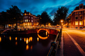 Amazing night in Amsterdam. Illuminated canal and bridge with typical dutch houses and bicycles - PhotoDune Item for Sale