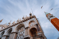 Detail of the bell tower Campanile di San Marco and the cathedral Cattedrale of St. Mark in Venice - PhotoDune Item for Sale
