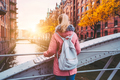 Back rear view of adult blond woman tourist with backpack enjoying autumn beautiful sunset scene on - PhotoDune Item for Sale