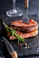 Beef Steak on a dark plate with rosemary and pepper - PhotoDune Item for Sale