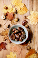 Edible chestnuts and autumn leaves - PhotoDune Item for Sale