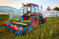 Manual seedling planter mounted to a tractor. - PhotoDune Item for Sale