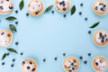 Blueberry muffins light blue background - PhotoDune Item for Sale