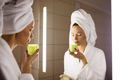 Woman And Mirror In Bathroom. Holding Cream In Hand. - PhotoDune Item for Sale