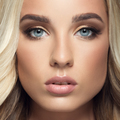 Blond Woman With Long Curly Beautiful Hair. Close Up Face - PhotoDune Item for Sale