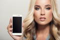 Beautiful Woman Holding Smartphone In Hand. Template Display. Close-up. - PhotoDune Item for Sale