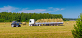 Loading Hay Bales Onto a Truck - PhotoDune Item for Sale