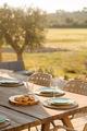 Dinner table setting in modern villa terrace - PhotoDune Item for Sale